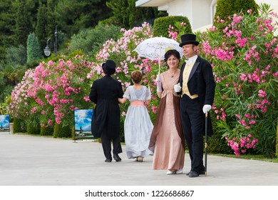Russia, Crimea, Alushta, Partenit, July 15, 2018 - Aivazovsky Sanatorium celebrates its birthday. Historical reconstruction, artists in ancient costumes of the 19th century stroll along the embankment