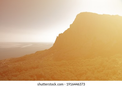 Russia, Crimea. Mountains background, high rock silhouette, sunlight scenery. Steep cliff view, nature background