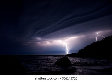 Russia, Crimea. Summer night in the Bay of Balaclava. In the sky with lightning and storm