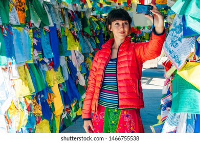 russia, Datsan - may 2017 girl makes selfie on the background of the flags