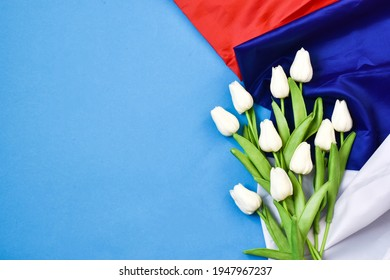 Russia day is a Russian holiday. June 12 Day of Russia. Flowers tulips and flag on a blue background.