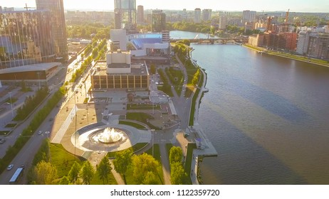 Russia, Ekaterinburg - June 7, 2018: Embankment of the central pond. Flight to skyscrapers and new buildings, From Dron