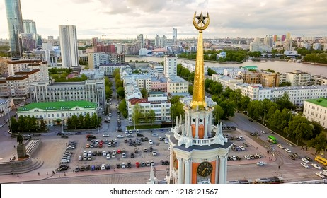 Russia, Ekaterinburg - June 7, 2018: We fly around the clock tower of the City Hall of Yekaterinburg building. Panorama of the city, From Dron