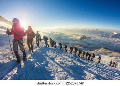 RUSSIA, Elbrus - JULY 15, 2018: a Group of people climbs the mountain Elbrus. Every year thousands of people climb the highest mountain in Russia and Europe