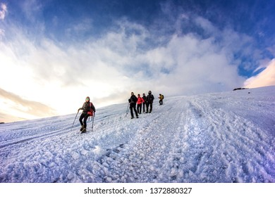 RUSSIA, Elbrus-JULY 29, 2018: a group of climbers follow each other down the mountain in a chain. Every year thousands of people go to the mountains.
