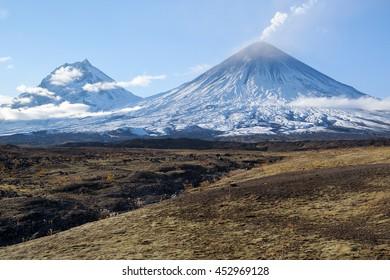 Russia, Far East, Kamchatka Peninsula. Klyuchevskaya Hill(4800m) and Kamen Volcano(4585m)The volcano of Klyuchevskaya Hill (4800 m) is the highest active volcano of Eurasia.