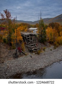 Russia. far East. Magadan region. Wooden bridge destroyed by ruthless time