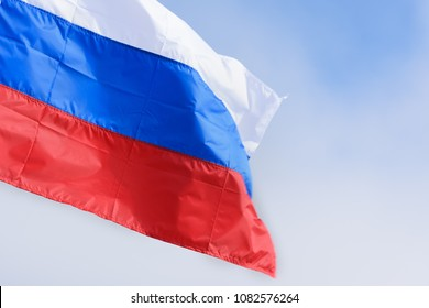 Russia flag waving in the blue sky