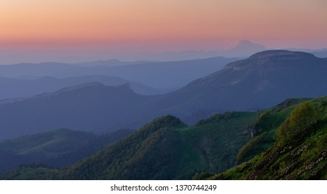 Russia. The formation and movement of clouds over the summer slopes of Adygea the Caucasus Mountains