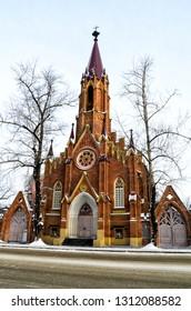 Russia, Irkutsk - January 13, 2013: Organ Hall. Irkutsk Regional Philharmonic. Roman Catholic Polish Church in winter, Siberia