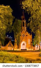 Russia, Irkutsk - May 28, 2016: Organ Hall. Irkutsk Regional Philharmonic. Roman Catholic Polish Church at night in summer