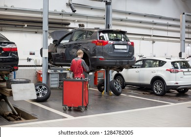 Russia, Izhevsk - April 21, 2018: Service center Toyota. Replacement and wheel alignment on a hydraulic lift.