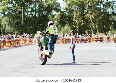 """Russia, Izhevsk - AUGUST 24, 2017: Moto-kvadro stunt show performed by experienced bikers. Two motobikes performed exciting tricks with a motorcycle and ATV at the event """"Bafi"""" Chekeril Sports Complex"""