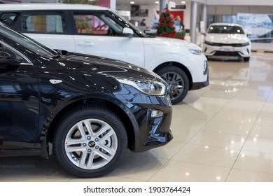 Russia, Izhevsk - December 28, 2020: KIA showroom. New modern cars in dealer showroom. Famous world brand. Prestigious vehicles.