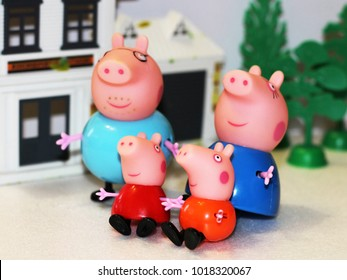 Russia, Izhevsk, February 4, 2018. Peppa pig toy, cheerful family and their home.