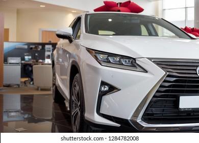 Russia, Izhevsk - October 20, 2018: Showroom Lexus. New car Lexus RX350 in dealer showroom. Modern transportation.