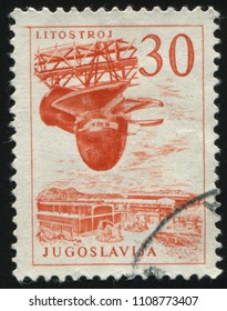 RUSSIA KALININGRAD, 12 NOVEMBER 2016: stamp printed by Yugoslavia, shows the Litostroy turbine factory, circa 1958
