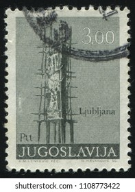 RUSSIA KALININGRAD, 12 NOVEMBER 2016: stamp printed by Yugoslavia, shows Memorial by O. Boljka at Ljubljana, circa 1974