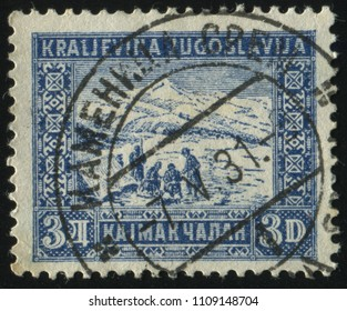 RUSSIA KALININGRAD, 12 NOVEMBER 2016: stamp printed by Yugoslaviya, shows some people in the mountains, circa 1953