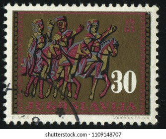 RUSSIA KALININGRAD, 12 NOVEMBER 2016: stamp printed by Yugoslaviya, shows horseback trio, circa 1963