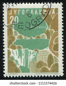 RUSSIA KALININGRAD, 12 NOVEMBER 2016: stamp printed by Yugoslavia, shows Tourist attractions Plitvice National Park, circa 1958