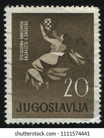 RUSSIA KALININGRAD, 12 NOVEMBER 2016: stamp printed by Yugoslavia, shows a person holding the shield, circa 1960