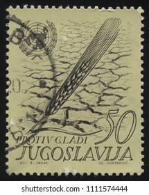RUSSIA KALININGRAD, 12 NOVEMBER 2016: stamp printed by Yugoslavia, shows parched earth an wheat, circa 1962