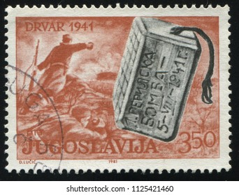 RUSSIA KALININGRAD, 12 NOVEMBER 2016: stamp printed by Yugoslavia, shows war scene and a bomb, circa 1965