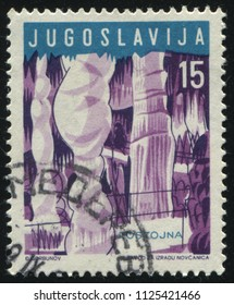 RUSSIA KALININGRAD, 12 NOVEMBER 2016: stamp printed by Yugoslavia, shows Postoina Cave, circa 1959