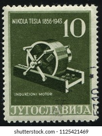 RUSSIA KALININGRAD, 12 NOVEMBER 2016: stamp printed by Yugoslavia, shows Induction Motor, circa 1956
