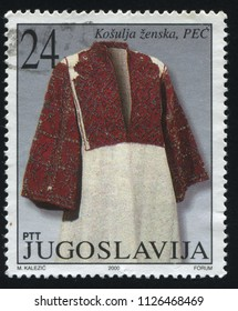RUSSIA KALININGRAD, 12 NOVEMBER 2016: stamp printed by Yugoslavia, shows woman national costum, circa 2000
