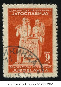 RUSSIA KALININGRAD, 12 NOVEMBER 2016: stamp printed by Yugoslavia, shows the statue symbolising the Labour and Agriculture, circa 1945