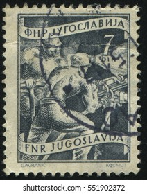 RUSSIA KALININGRAD, 12 NOVEMBER 2016: stamp printed by Yugoslavia, shows two workers in the mine, circa 1950