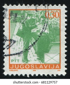 RUSSIA KALININGRAD, 12 NOVEMBER 2016: stamp printed by Yugoslavia, shows a postman and a resident, circa 1986
