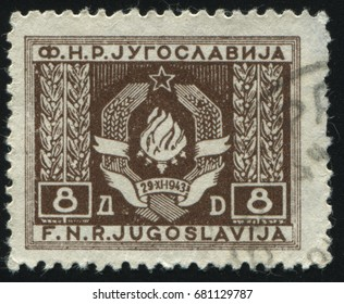 RUSSIA KALININGRAD, 12 NOVEMBER 2016: stamp printed by Yugoslavia, shows Arms of the Federated People's Republic, circa 1946