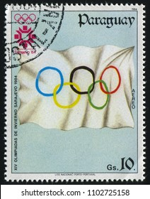RUSSIA KALININGRAD, 19 APRIL 2017: stamp printed by Paraguay, shows Olympic Flag, circa 1984