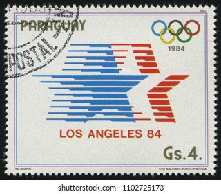 RUSSIA KALININGRAD, 19 APRIL 2017: stamp printed by Paraguay, shows the symbol of Summer Olympics at Los Angeles, circa 1984