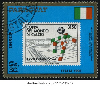 RUSSIA KALININGRAD, 19 APRIL 2017: stamp printed by Paraguay, shows the Emblem of World Cup Soccer Championships, Italy, circa 1988