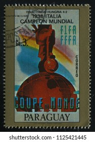 RUSSIA KALININGRAD, 19 APRIL 2017: stamp printed by Paraguay, shows poster devoted to soccer world cup in Italia, circa 1938