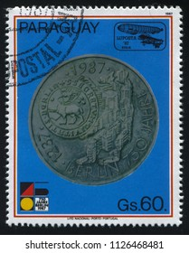 RUSSIA KALININGRAD, 19 APRIL 2017: stamp printed by Paraguay, shows a coin issued in honour of 750 th anniversary of Berlin, circa 1987