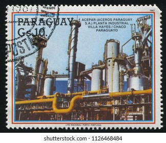 RUSSIA KALININGRAD, 19 APRIL 2017: stamp printed by Paraguay, shows ACEPAR Industrial Plant, circa 1987