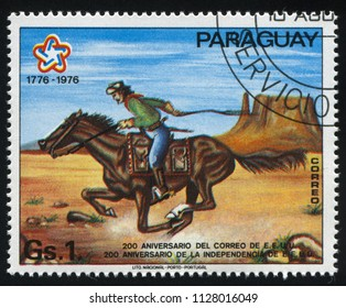 RUSSIA KALININGRAD, 19 APRIL 2017: stamp printed by Paraguay, shows Pony Express rider, circa 1976