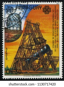 RUSSIA KALININGRAD, 19 APRIL 2017: stamp printed by Paraguay, shows Herschel's telescope, Cerro Tololo Observatory  in Chile, circa 1983