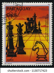 RUSSIA KALININGRAD, 19 APRIL 2017: stamp printed by Paraguay, shows chess figures devoted to the 60th anniversary of International Chess Federation, circa 1984