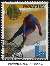 RUSSIA KALININGRAD, 19 APRIL 2017: stamp printed by Paraguay, shows Annie Borckinck speed skater at Winter Olympics in Lake Placid, circa 1980