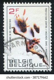 RUSSIA KALININGRAD, 20 OCTOBER 2015: stamp printed by Belgium, shows Industrial Fire Prevention Campaign, circa 1973