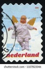 RUSSIA KALININGRAD, 21 JUNE 2017: stamp printed by Netherlands shows baby angel, circa 1999