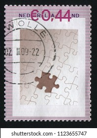 RUSSIA KALININGRAD, 21 JUNE 2017: stamp printed by Netherlands shows pieces puzzle, circa 2009