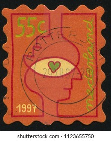 RUSSIA KALININGRAD, 21 JUNE 2017: stamp printed by Netherlands shows Stylized people head to head showing either a star or heart in the center., circa 1997