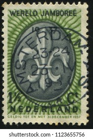 RUSSIA KALININGRAD, 21 JUNE 2017: stamp printed by Netherlands shows Boy Scout Emblem, circa 1937